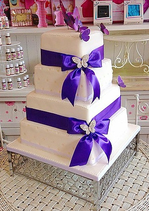 4 tier blue ribbons wedding cake